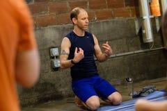Yoga Studio Editorial. SPRINGFIELD, OR - MARCH 11, 2018: Male yoga instructor teaching an intermediate class at Common Bond Yoga, an urban yoga startup company Stock Photo