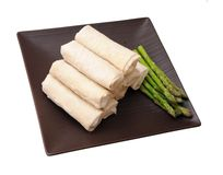 Springroll and asparagus. On dish isolated on white background Stock Photography