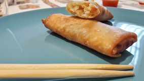 Springroll and chopstick. Delicious Springroll and chopstick stock image