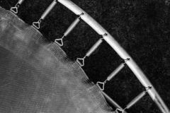 Springs attached to the trampoline frame royalty free stock photo