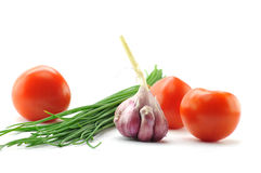 Springs onion, garlic and tomatoes. Spring onion, garlic and tomatoes, Mediterranean food ingredients Stock Image