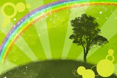 The Springtime.The Abstract background. The Spring background with rainbow and tree Stock Photo