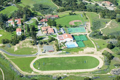 Springtime aerial view of Villanova Prep school with track, pool, baseball diamond, tennis courts and campus in view, Ojai, CA Royalty Free Stock Image
