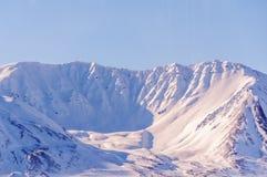 Springtime in Alaska, snow covered mountain Stock Photos