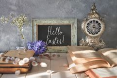 Springtime background with an open book, blackboard with text an Stock Images