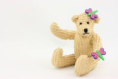 Springtime Bear. A cute little teddy bear all set for spring time fun with his two little dragonfly or butterfly friends Stock Images