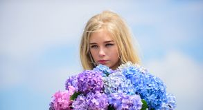 Springtime bloom. Pollen allergy. Gentle flower for delicate woman. Girl tender blonde hold hydrangea flowers bouquet. Allergy free life. Stop allergy blooming stock photography