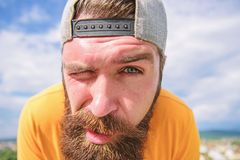 Springtime concept. Hipster with freckles face close up. Man with beard on sunny day. Skin care and sun tan. Bearded. Hipster with stylish mustache. Young and stock photos