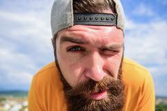 Springtime concept. Hipster with freckles face close up. Man with beard on sunny day. Skin care and sun tan. Bearded. Hipster with stylish mustache. Young and stock images
