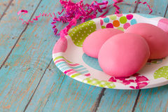 Springtime Cookies with festive decorations. Easter cookies on a springtime plate with pink easter grass stock photos