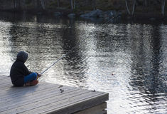 Springtime fishing in a lake Royalty Free Stock Image