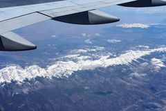 Flight Above Snow-Capped Mountains Royalty Free Stock Photography