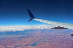 Flight Above the Clouds and a Wide Canyon River Stock Images