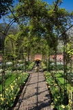 Springtime in formal garden with pergola Royalty Free Stock Images