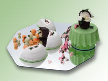 Springtime marzipan food arrangement. On green royalty free stock photography