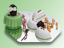 Springtime marzipan food arrangement. On green stock photo