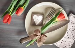 Springtime menu concept with fresh tulips and heart decoration o Royalty Free Stock Photography