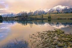 Dramatic Springtime Sunset Colors Blue Lake Canada Landscape Alberta Foothills royalty free stock photo
