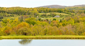 Springtime pond and Taconic hills Stock Images