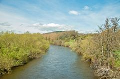 Springtime scenery along the River Wye in the English countryside. A summertime river scene in the English countryside of Herefordshire in the United Kingdom Stock Photography