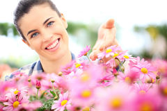 Springtime, smiling woman in the garden of daisies flowers Royalty Free Stock Photo