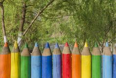 Fence with colored pencils Stock Photos