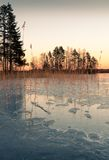 Springtime sunset and the wet ice Stock Photos
