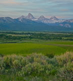 Springtime in the Tetons. Sun sets on the Grand Tetons in spring time Royalty Free Stock Images