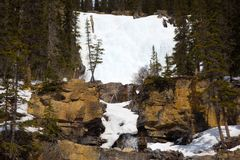Snow melting in the rockies Stock Photos