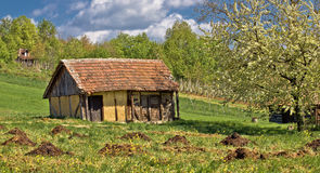 Springtime view on old traditional cottage. Made of wood and mud Royalty Free Stock Photography