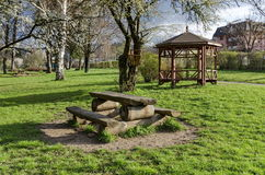 Springtime view with place for respite in the park Stock Photos