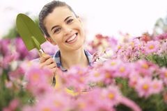 Springtime woman in garden with tools in hands. Springtime woman smiling in garden with tools in hands Royalty Free Stock Photo