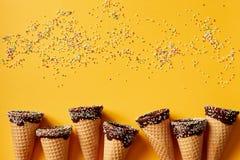 Sprinkle Covered Ice Cream Cones Stock Photo