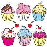 Sprinkle cupcakes. Cupcakes in different colors with sprinkles and cherry Stock Photography