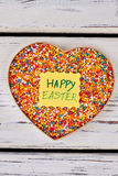 Sprinkle dots and Easter card. Heart shaped box with sweets stock images