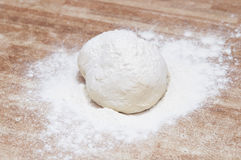 Sprinkle flour on dough Royalty Free Stock Photography