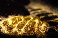 Sprinkle glitter gold dust. Textured abstract background elegant Royalty Free Stock Photo