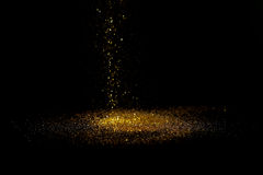 Sprinkle gold dust on a black background Stock Photo