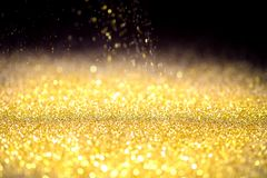 Sprinkle gold dust on a black. Background with copy space Stock Photography