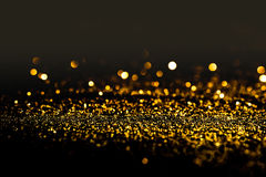 Free Sprinkle Gold Dust On A Black Background Stock Photos - 87770633