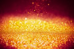 Sprinkle gold dust on a red background Stock Photos