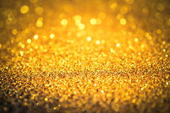 Sprinkle gold dust on a red background Royalty Free Stock Image