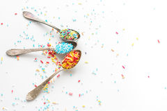 Sprinkle a teaspoon. Blue and white sprinkles on teaspoon Royalty Free Stock Photo