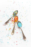 Sprinkle a teaspoon. Blue and white sprinkles on teaspoon Stock Photos