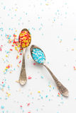 Sprinkle a teaspoon. Blue and white sprinkles on teaspoon Royalty Free Stock Photography