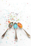 Sprinkle a teaspoon. Blue and white sprinkles on teaspoon Royalty Free Stock Images
