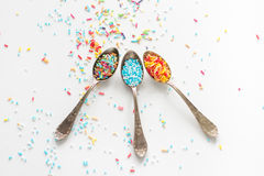 Sprinkle a teaspoon. Blue and white sprinkles on teaspoon Stock Photography