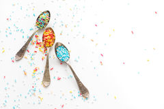 Sprinkle a teaspoon. Blue and white sprinkles on teaspoon Stock Images