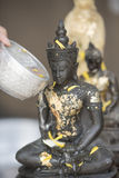 Sprinkle water onto a Buddha image, Season background Stock Image