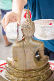 Sprinkle water onto a buddha in song klan festival Thailand Stock Images